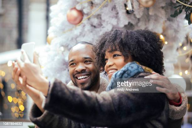 Young couple taking a christmas selfie