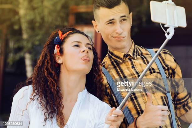 Young couple taking a funny selfie