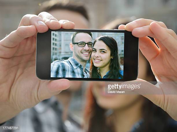 young couple taking a picture of themselves