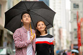 Young couple taking a romantic walk in the rain