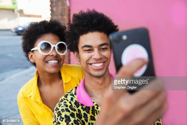 young couple taking a selfie - facebook stock pictures, royalty-free photos & images