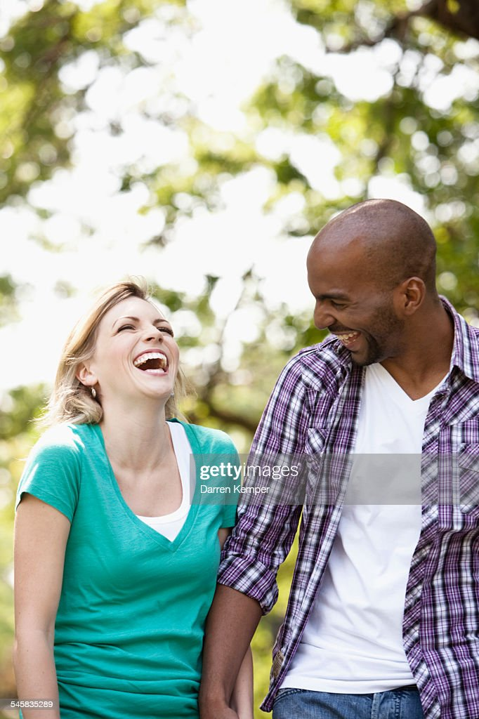 Young couple taking a walking in a park : Stock Photo