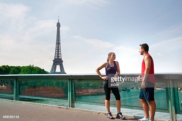 Young couple taking break from Exercise to talk