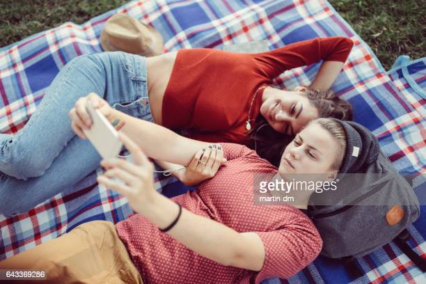 Young couple taking selfie at a picnic
