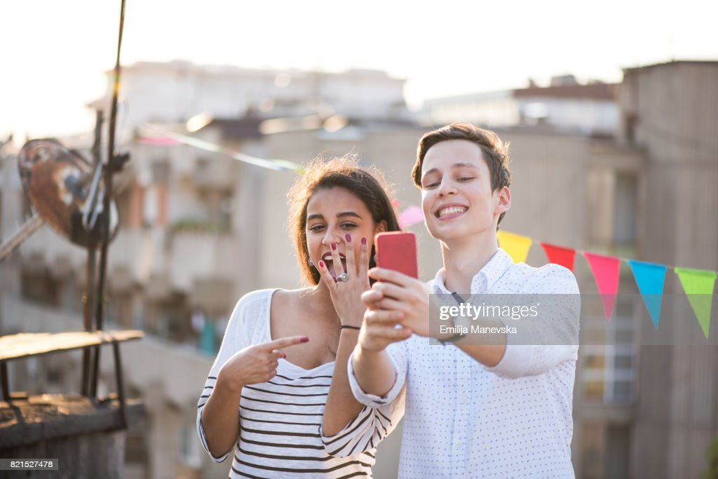Young couple taking selfie of engagement ring : Stock Photo
