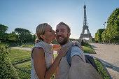 Young couple taking selfie portrait in Paris