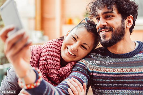 Young couple taking selfie together