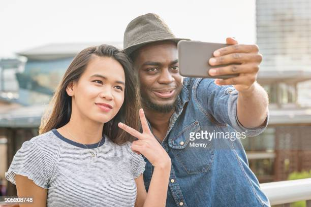 Young Couple taking Selfies with Smart Phone Sydney Darling Harbour