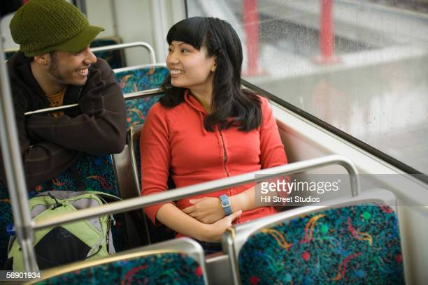 Young couple talking on train