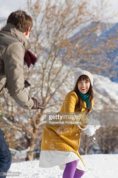 young couple together in the snow - orem utah stock pictures, royalty-free photos & images