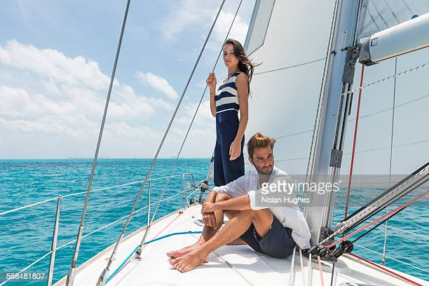 Young couple together on sailboat