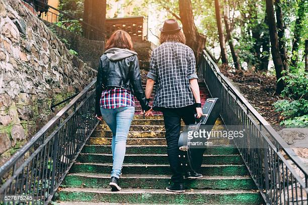 young couple together - guitar case stock pictures, royalty-free photos & images