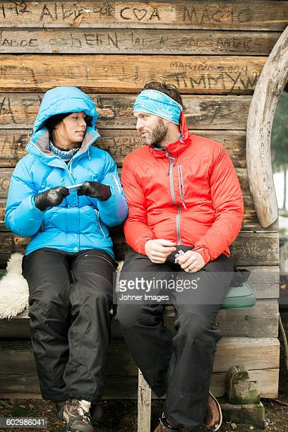 young couple together - winter coat stock pictures, royalty-free photos & images