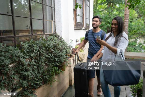 young couple traveler arrival at accommodation - bed and breakfast or hostel / hotel - guest stock pictures, royalty-free photos & images