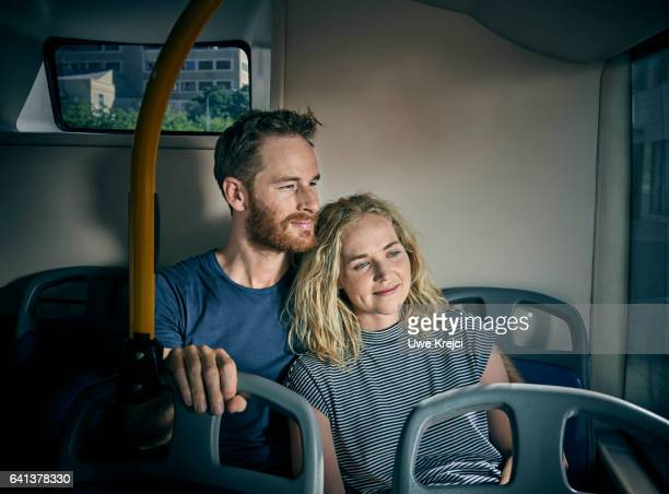 Young couple traveling on a bus