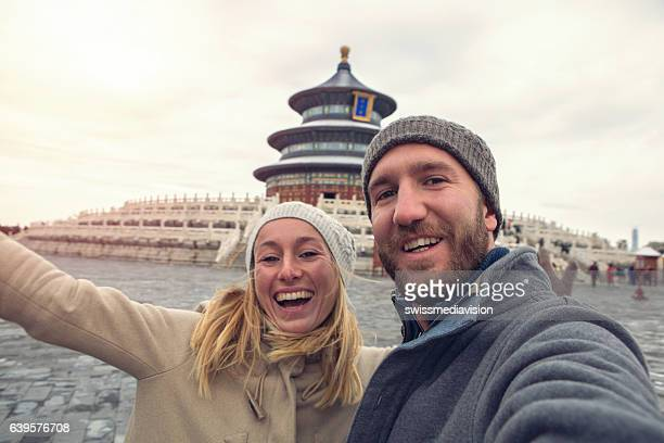 Young couple traveling take selfie with Temple of Heaven,Beijing