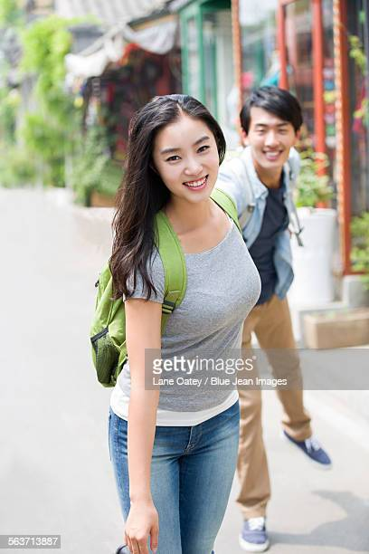 Young couple travelling in Beijing Hutong
