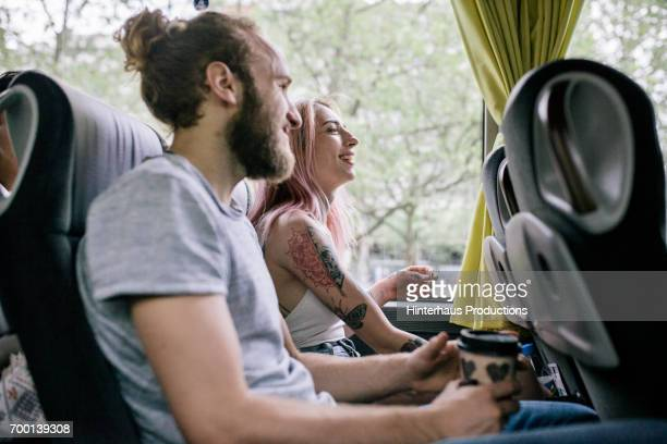 Young Couple Travelling Together On Bus