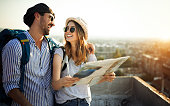 Young couple travelling with a map in the city