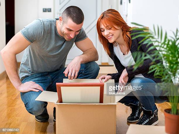 Young couple unpacking together
