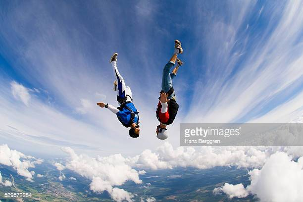 young couple upside-down in air - freaky couples stock photos and pictures