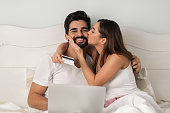 young couple using credit card for
