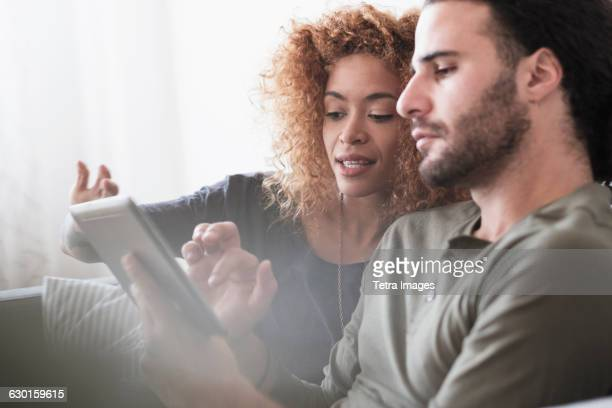 Young couple using tablet.
