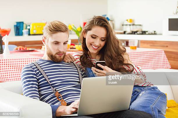 Young couple using technologies
