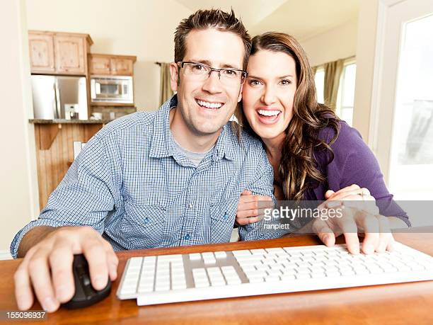 young couple using webcam / internet - webcam stock photos and pictures