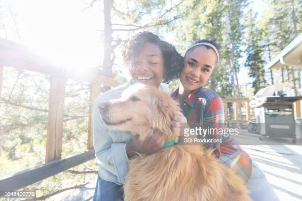 young couple vacation together in the mountains - black hairy women stock pictures, royalty-free photos & images