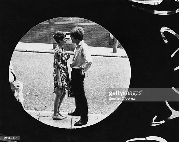 A young couple viewed through the window of the Biba boutique in Kensington London July 1966