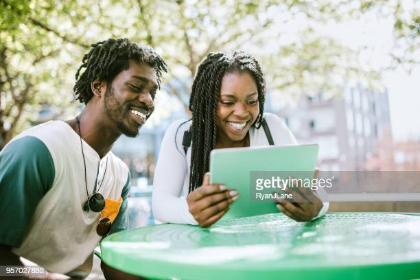 Young Couple Viewing Digital Tablet in Downtown Seattle
