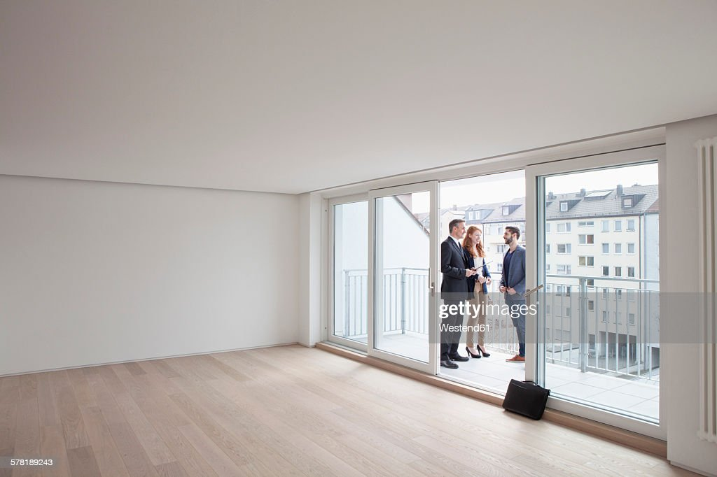 Young couple viewing flat with estate agent : Stock Photo