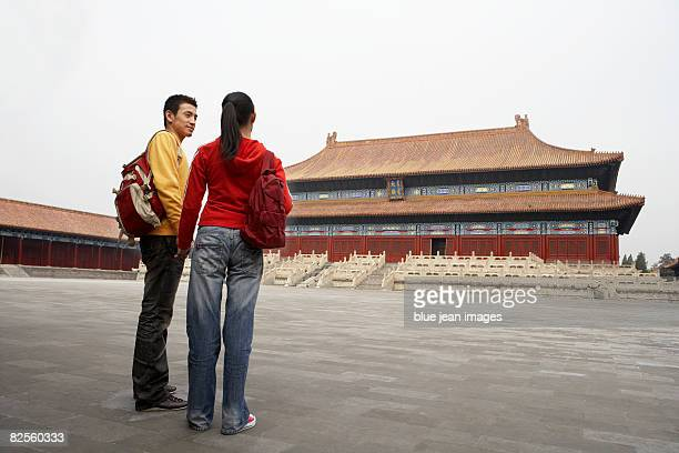 A young couple visit a tourist site in China.