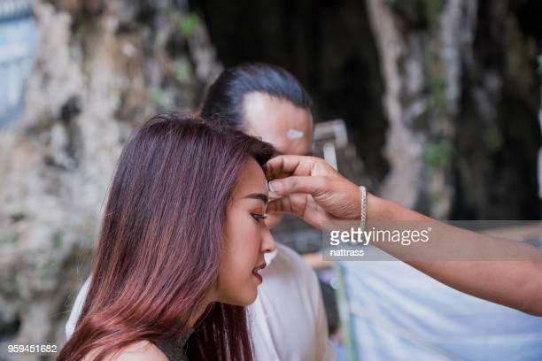 Young couple visiting the Batu Caves near Kuala Lumpur