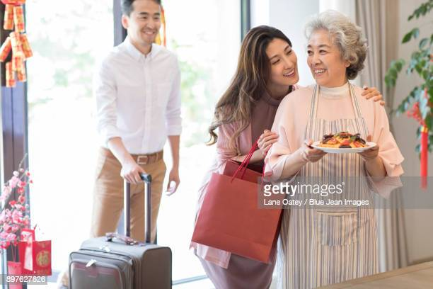 Young couple visiting their mother during Chinese new year