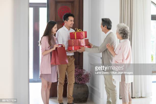 Young couple visiting their parents during Chinese new year