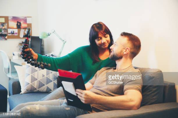 young couple vlogging at home - social media marketing stock pictures, royalty-free photos & images