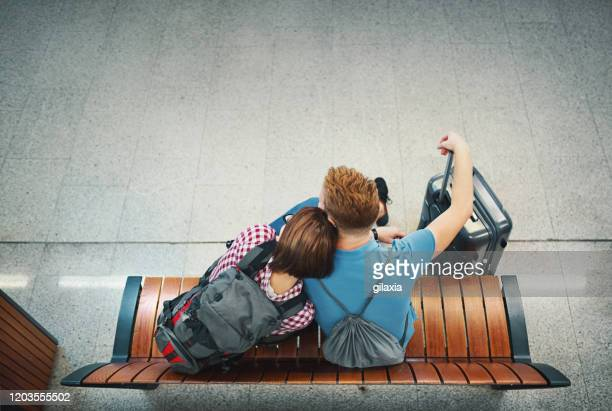 young couple waiting for a train. - subway station stock pictures, royalty-free photos & images