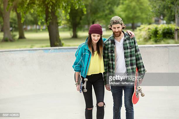 Young couple walking at skate park