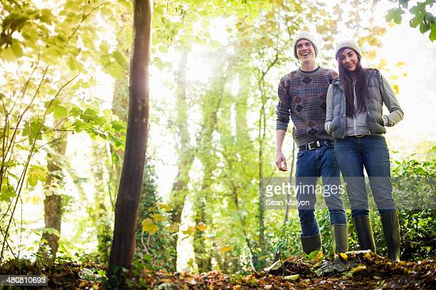 Young couple walking in forest