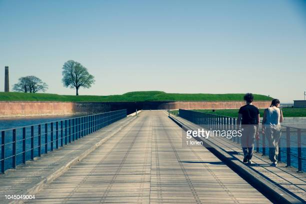 young couple walking in port of elsinore. - helsingor stock pictures, royalty-free photos & images