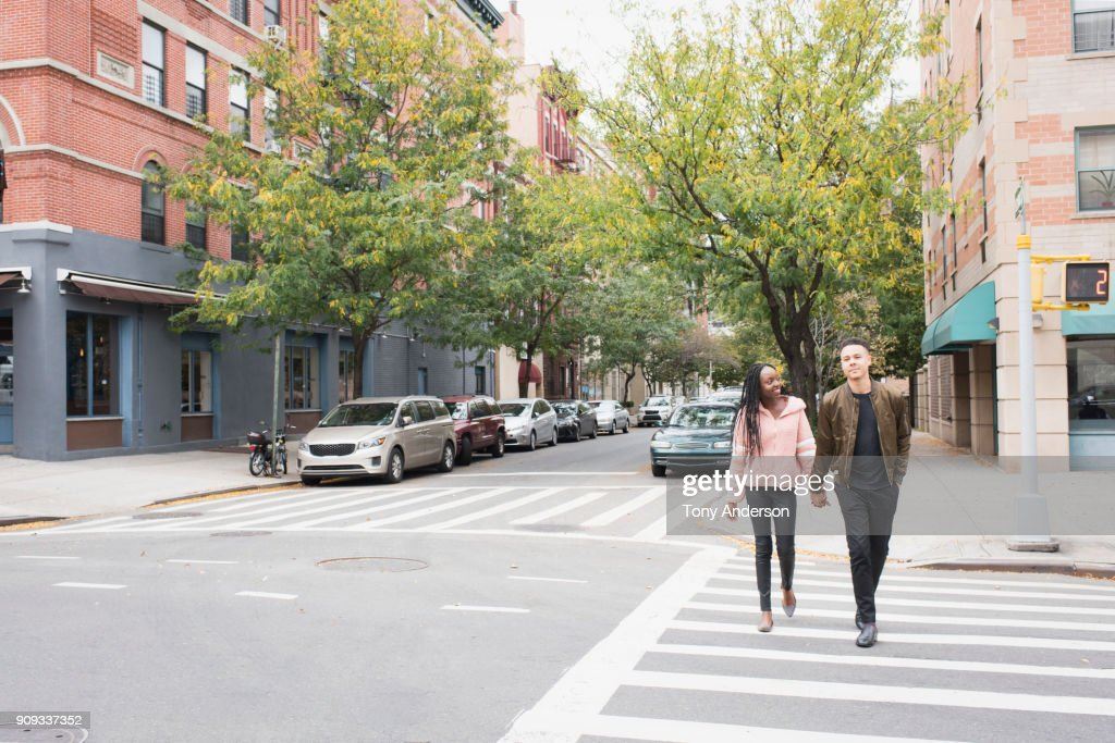 Young couple walking in the city : Stock Photo