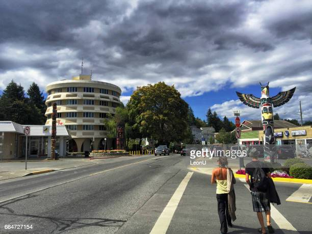 young couple walking in the crosswalk, duncan, bc,canada - istock photo stock pictures, royalty-free photos & images