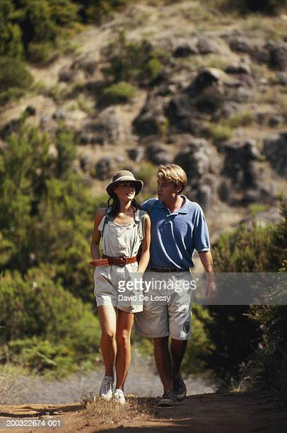 Young couple walking in woods