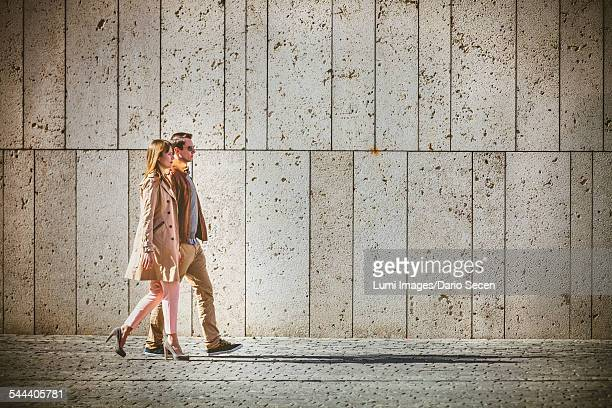 Young couple walking through Old Town, Munich, Bavaria, Germany