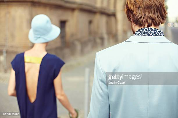 A young couple walking through the city