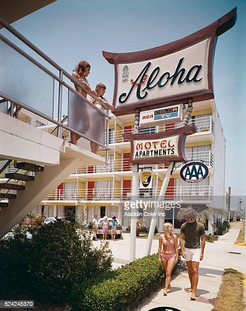 A young couple walks past the Aloha Motel