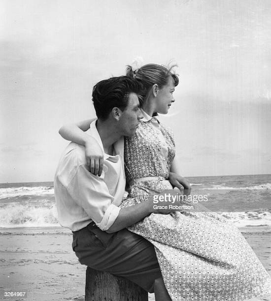 Young couple watch the waves rolling in. Original Publication: Picture Post - 7941 - Butlin's Holiday Camp - unpub.