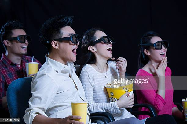 Young couple watching 3D movie in cinema